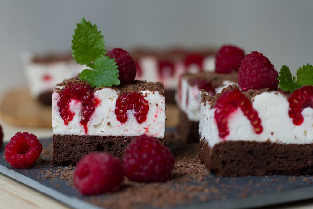 Cake with raspberries and whipped cream