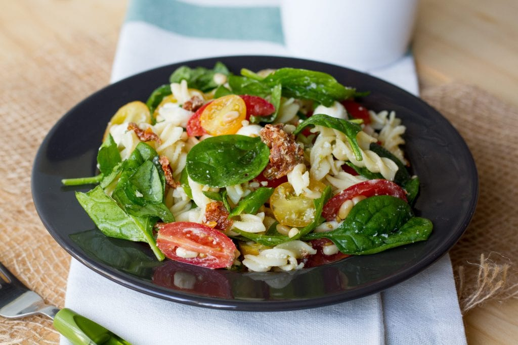 Pasta, tomato and spinach salad