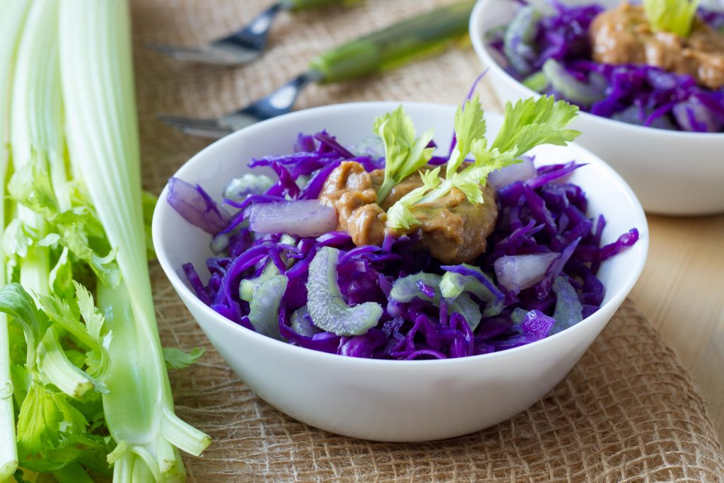 Red cabbage, pineapple, celery and satay sauce salad.