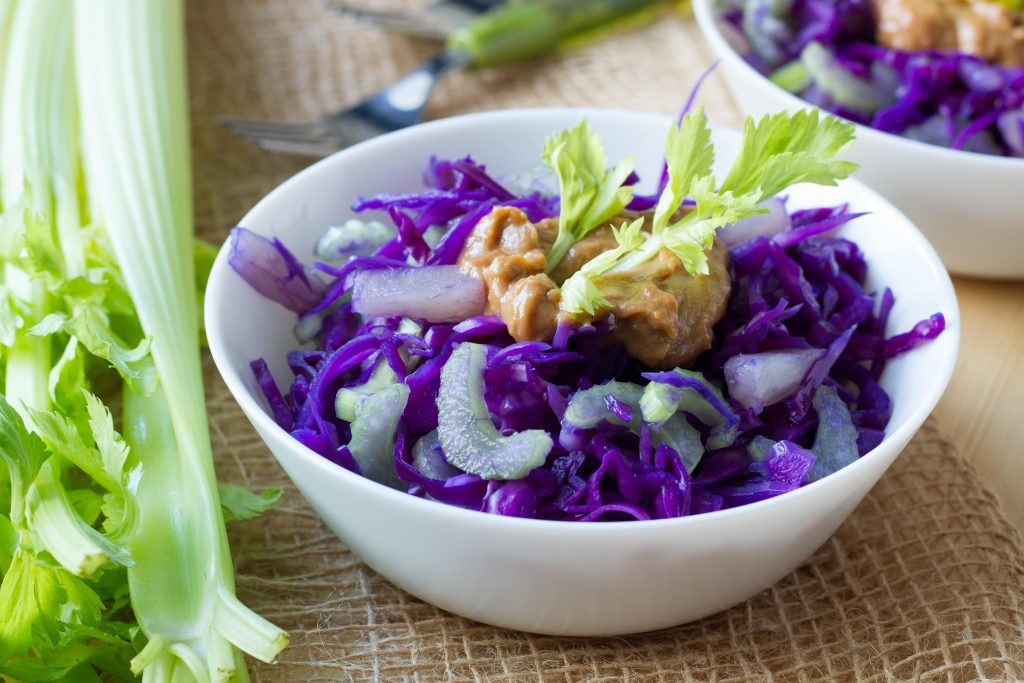 Red cabbage, celery. pineapple and satay sauce salad.